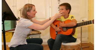Einzelgitarrenunterricht-Kind